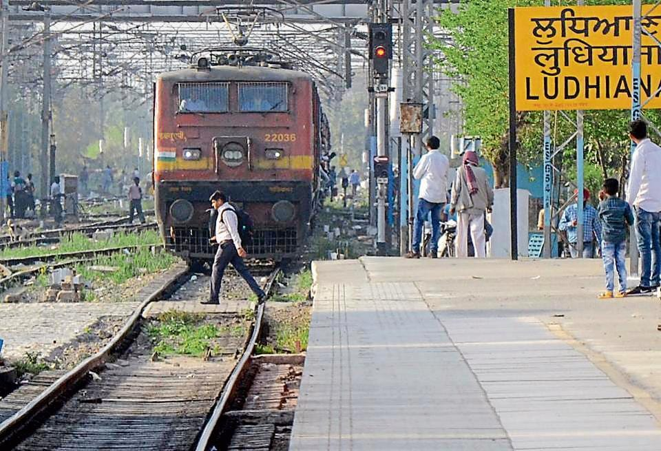 A man crossing railway line even as a train is approaching in Ludhiana on Friday.