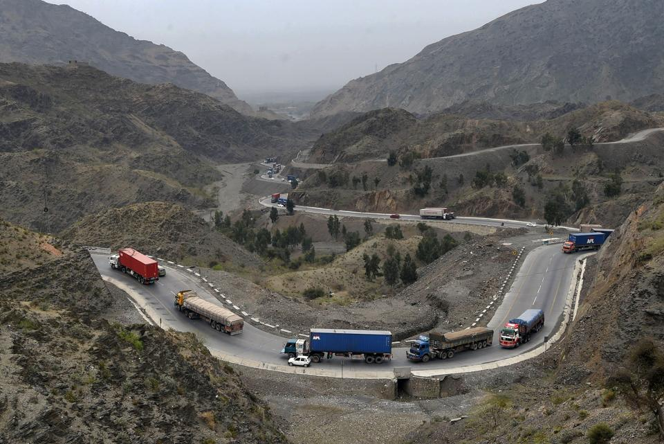 Trucks and other vehicles travel in the mountainous area near Torkham, close to the Pakistan-Afghanistan border. Pakistan on March 20 ordered the border with Afghanistan to be reopened