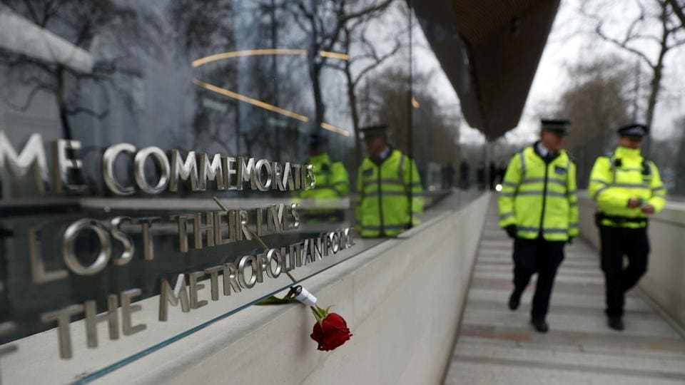 A floral tribute is seen outside New Scotland Yard following a recent attack in Westminster, in London.