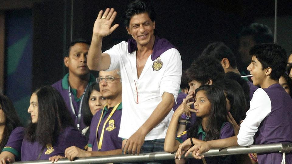 Kolkata Knight Riders co-owner Shah Rukh Khan waves to his team during an IPL match  at Eden Gardens.