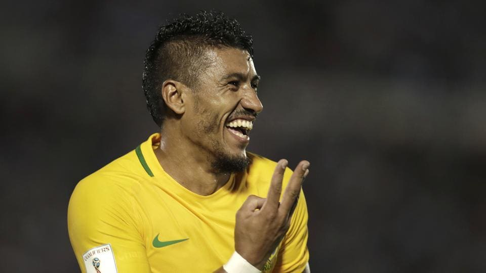 Brazil's Paulinho celebrates his hat trick during a 2018 World Cup qualifying match against Uruguay in Montevideo.