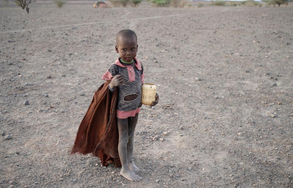 A Turkana boy holds a plastic carrying his breakfast in a village near Loiyangalani, Kenya, March 21, 2017. Picture taken on March 21, 2017. REUTERS/Goran Tomasevic (REUTERS)