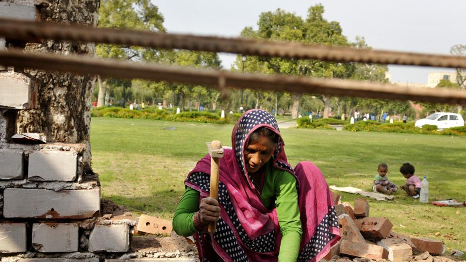 A woman at work at a construction site in Delhi,  March 7. India is a country not just with the greatest number of people to count, but with over 140 years of experience in household census surveys, and with the world's largest number of poor.