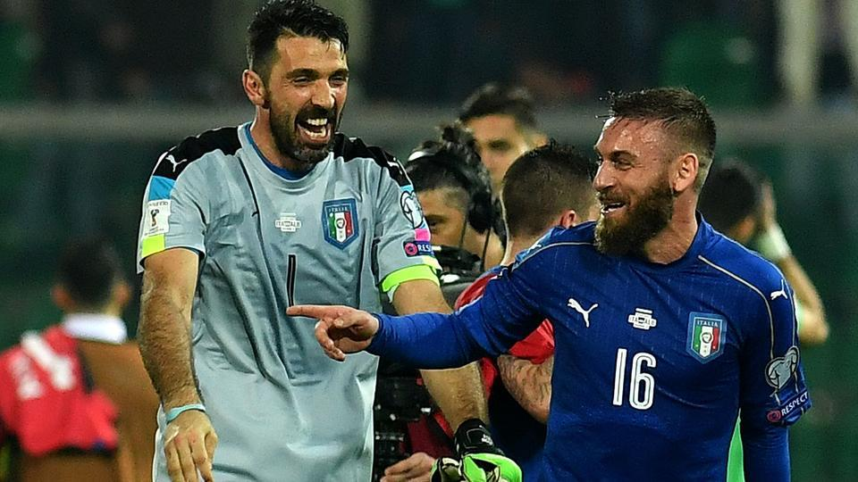 Gianluigi Buffon (L) jokes with Italy's midfielder Daniele De Rossi at the end of the FIFA World Cup 2018 qualifier against Albania.