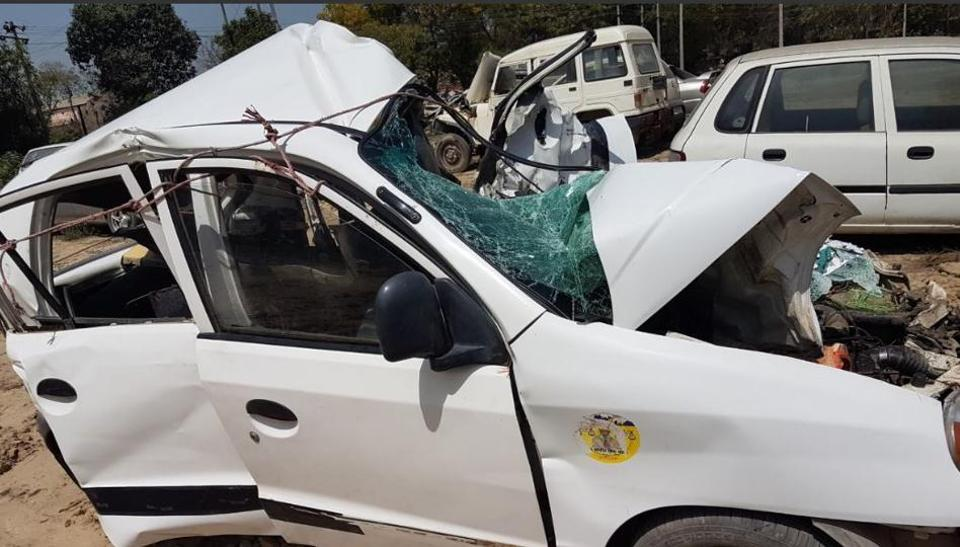 Mangled remains of the car involved in the accident on the NH­64 near Barnala on Saturday.