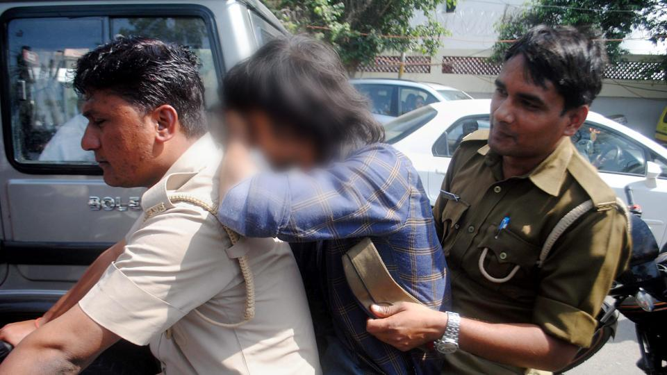 'Anti-Romeo' squad of the Uttar Pradesh police detains a youth in Lucknow on Wednesday.