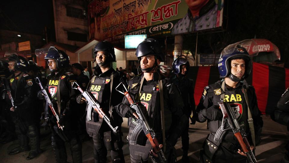 Bangladeshi soldiers from Rapid Action Battalion or RAB stand guard where a suicide bomber detonated himself in Dhaka, Bangladesh on March 24.