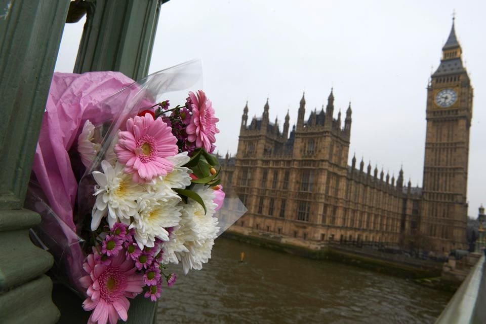 Flowers are placed at the Westminster Bridge.