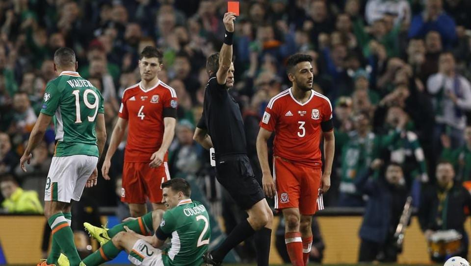 Wales' Neil Taylor is sent off by referee Nicola Rizzoli as Republic of Ireland's Seamus Coleman lies injured.