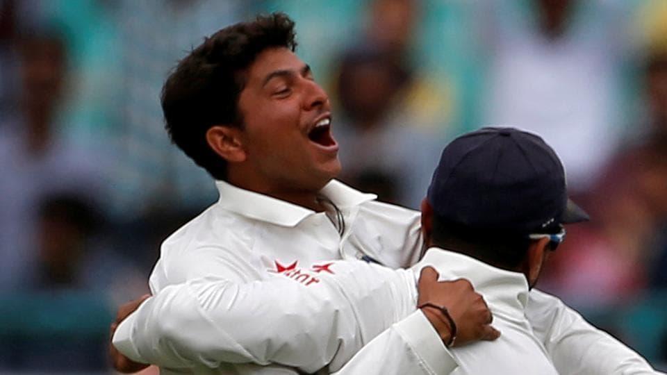 India's Kuldeep Yadav and Murali Vijay celebrate the dismissal of Australia's Peter Handscomb on Day 1 of the fourth Test in Dharamsala.