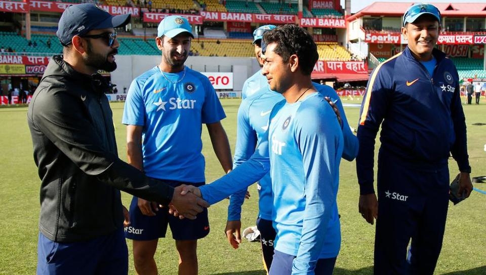 Kuldeep Yadav being congratulated by Virat Kohli after getting his Test cap ahead of the fourth India vs Australia Test in Dharamsala.