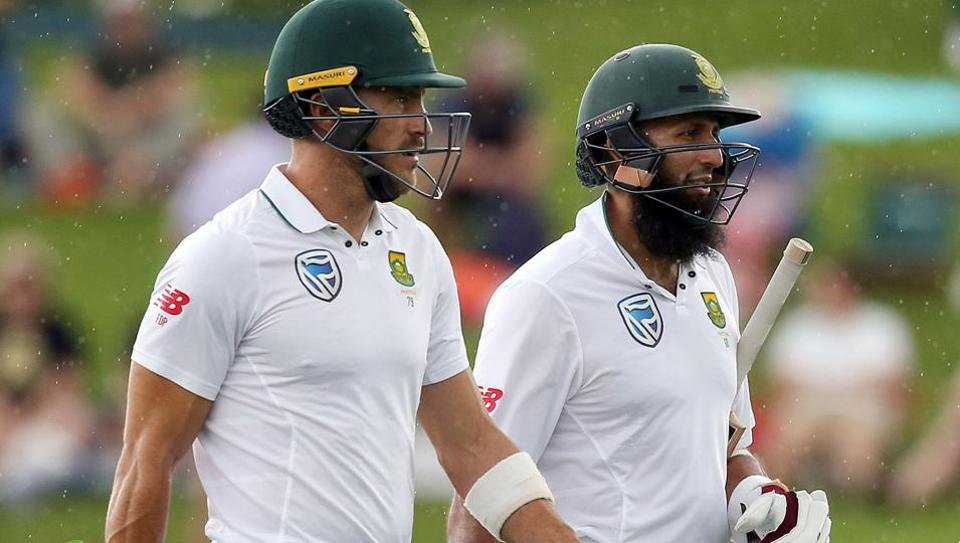South Africa's Faf du Plessis (left and Hashim Amla walk off for an early lunch during day one of the third Test cricket match between New Zealand and South Africa at Seddon Park in Hamilton on Saturday.