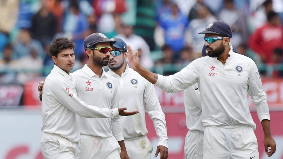 Kuldeep Yadav (left) celebrates after taking a wicket during the India vs Australia fourth Test in Dharamsala. Get live cricket score of India vs Australia Dharamsala Test here.