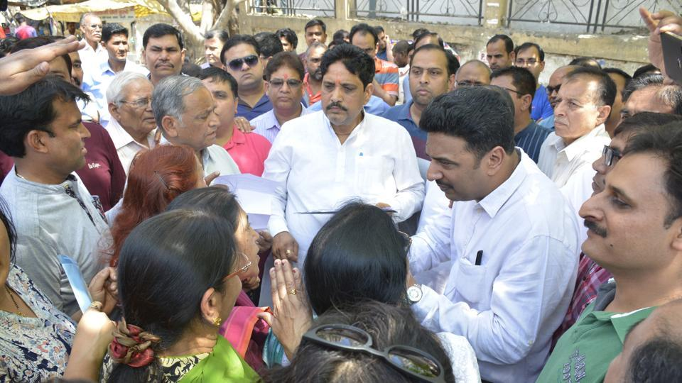 MLA Sunil Sharma (centre) with Indirapuram residents and GDA officials at the 'sewer panchayat' on Saturday.