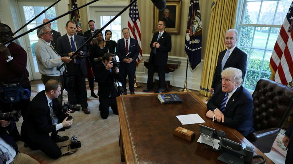 US President Donald Trump talks to journalists at the Oval Office of the White House after the AHCA health care bill was pulled before a vote in Washington.