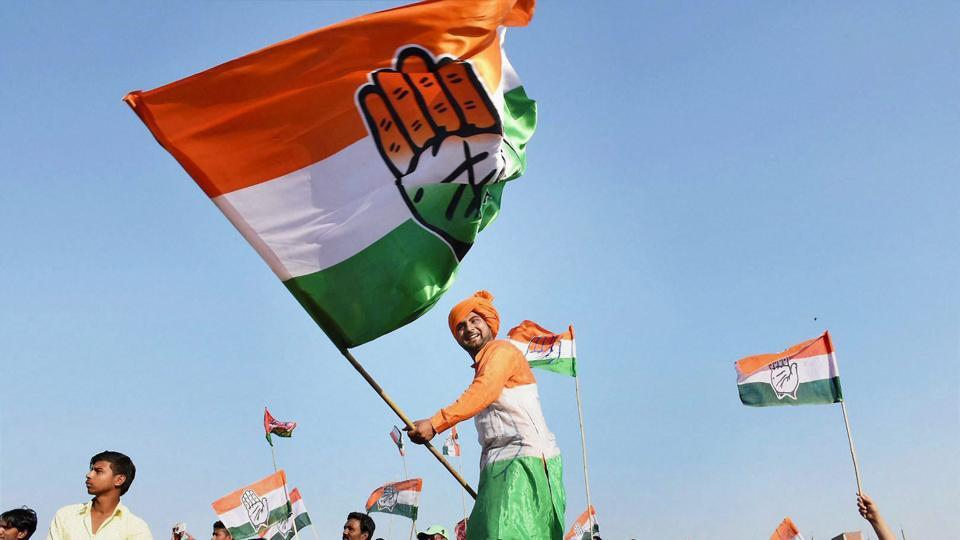 A Congress supporter waving flag during Rahul Gandhi's rally ahead of phase 7 of the Uttar Pradesh assembly elections in Jaunpur.