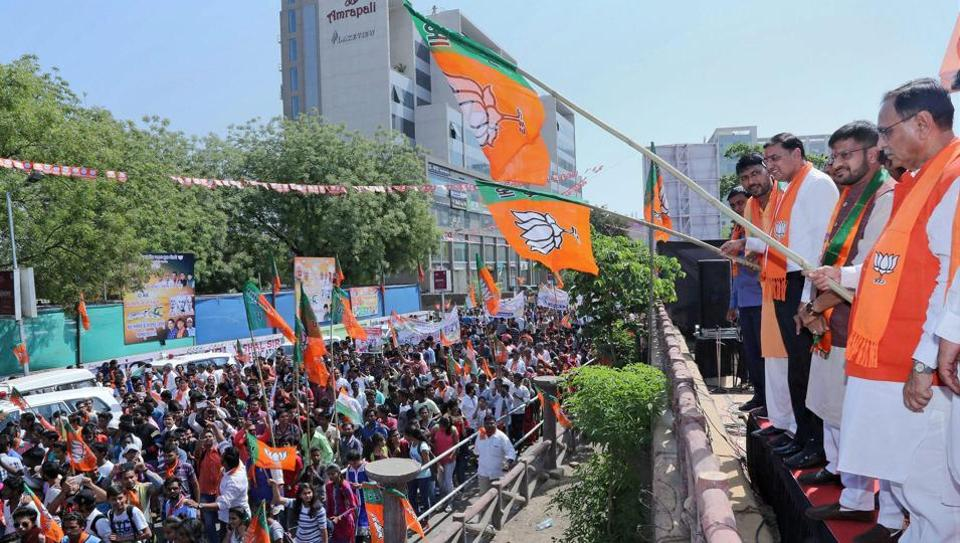 Gujarat chief minister Vijay Rupani flags off the traditional march on the occasion of 'Shahid Divas' in Ahmedabad on Thursday. BJP looks to revive Hindutva to retain its hold in Gujarat.