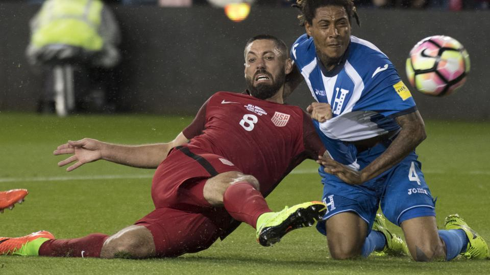Clint Dempsey (left) scores getting past Honduras defender Henry Figueroa during their 2018 World Cup qualifier at Avaya Stadium in San Jose on Friday.