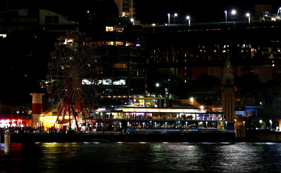 The rides at Luna Park seen during the tenth anniversary of Earth Hour in Sydney, Australia. (David Gray / REUTERS)