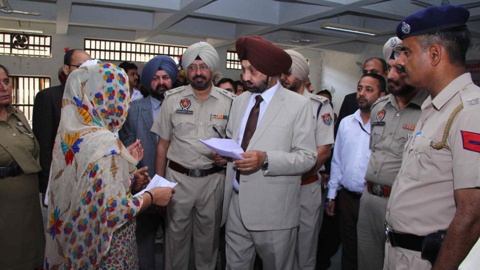 Justice Darshan Singh talking to a jail inmate in Faridkot on Saturday.