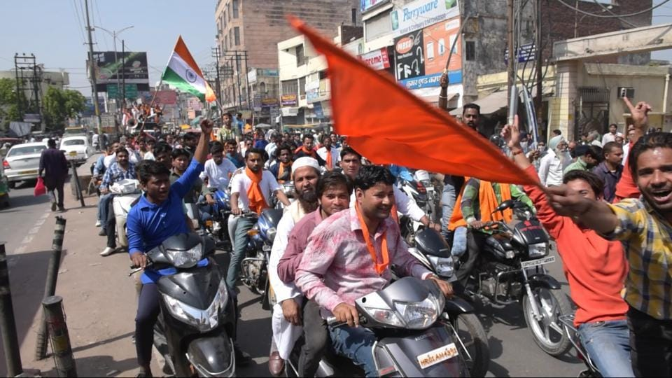 Members of Hindu Yuva Vahini during a procession in Saharanpur, western UP to celebrate the appointment of Yogi Adityanath as chief minister of UP.