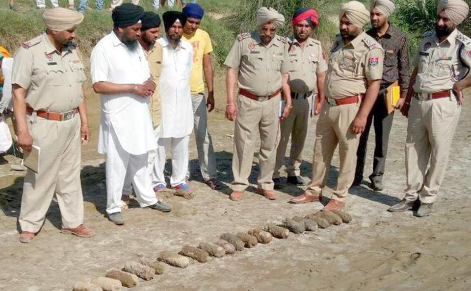 Punjab police officials inspected the old bombs founds near Goindwal Sahib in district Tarn Taran on Sunday.