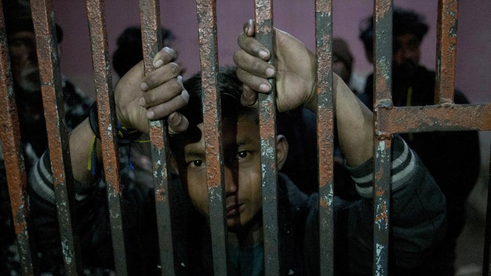 An arrested Indian fishermen looks out at a lock up at a police station in Karachi, Pakistan, on January 27.