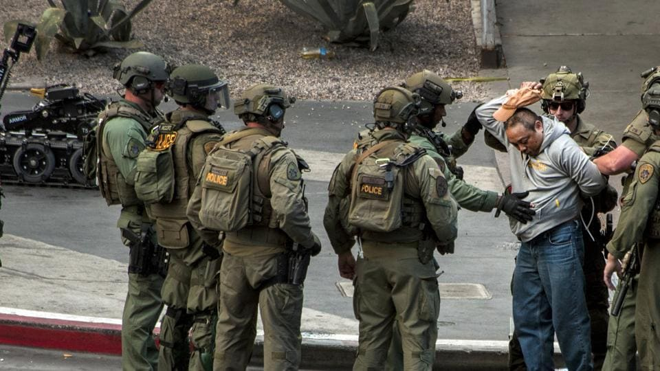 Suspect surrenders to SWAT officers after the shooting near the Cosmopolitan hotel-casino in Las Vegas.