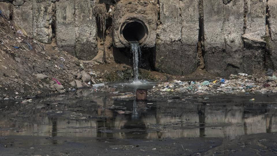 A drain opens into the river at Bharat Nagar.  (Satish Bate/HT Photo)