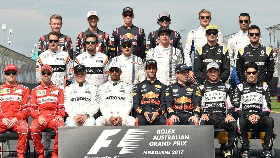 The class of 2017 -- Formula One drivers pose for the customary group photograph just before the start of the F1 Australian Grand Prix at Albert Park in Melbourne on Sunday. (AFP)