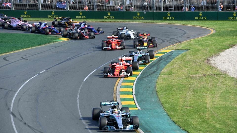 At the start of the Formula One Australian Grand Prix at Albert Park in Melbourne on Sunday, Mercedes' British driver Lewis Hamilton took the lead from pole position and looked set for a win but Sebastian Vettel had other ideas. (AFP)