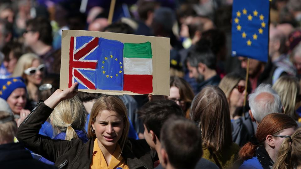 A demonstrator holds a placard bearing a Union, EU during an anti Brexit, pro-European Union (EU) march in London. The Unite for Europe march, which saw many people carrying bright blue EU flags, came just days before Britain is expected to begin its formal separation from the other 27 nations in the EU. (Daniel Leal-Olivas/AFP)