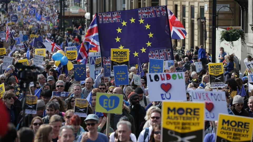 Demonstrators march against Brexit. Organizers considered delaying the long-planned march because of the attack - in part to avoid putting extra strain on British police - but decided to go ahead (Daniel Leal-Olivas/AFP)