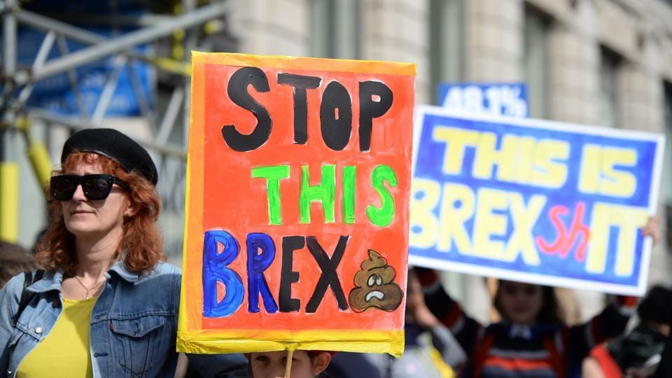 Demonstrators hold placards as they prepare to participate in an anti Brexit, pro-European Union (EU) march. Liberal Democrat leader Tim Farron told the crowd that 'democracy continues' despite the assault. 'We stand in defiance of that attack, he said. (Chris J Ratcliffe/AFP)