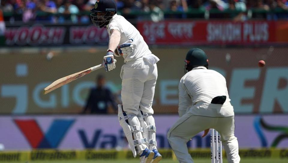India cricket team's KLRahul takes evasive measures against a sharp-bouncing ball during Day 2 of play of the fourth Test vs Australia cricket team in Dharamsala on Sunday.