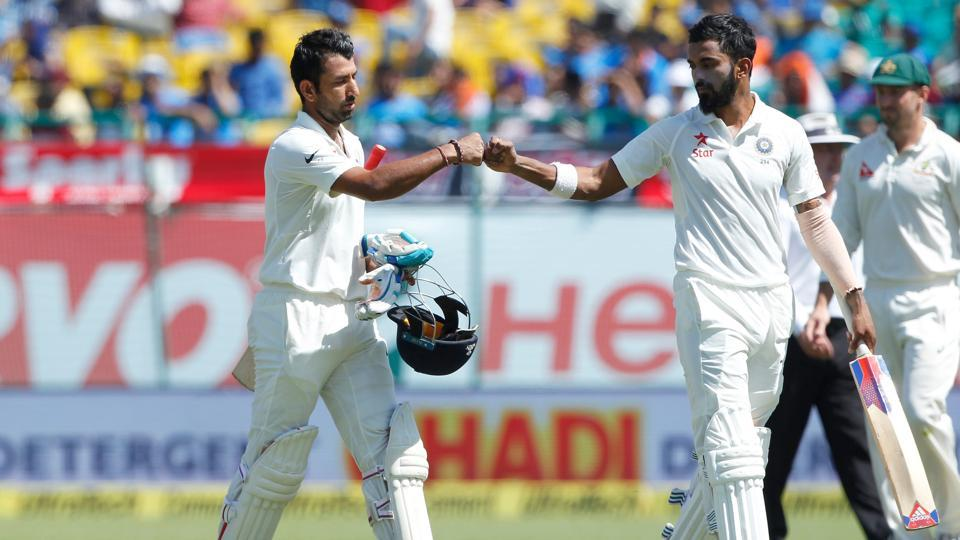 Cheteshwar Pujara and KL Rahul walk back after the first session during day two of the fourth test match between India and Australia in Dharamsala.