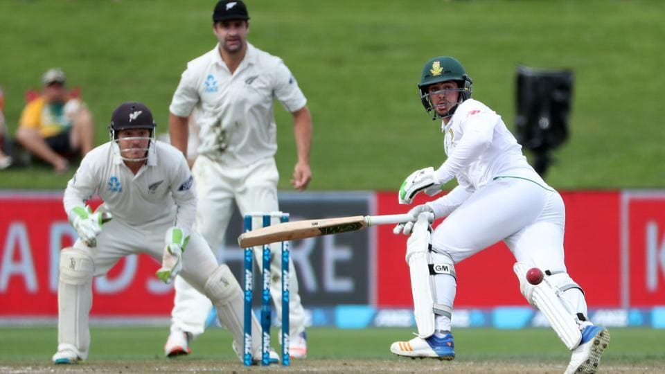 Quinton de Kock of South Africa (right) dives for his crease on the second day of the third Test against New Zealand in Hamilton on Sunday.