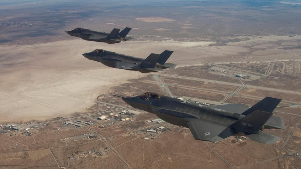 Three F-35 Joint Strike Fighters, (rear to front) AF-2, AF-3 and AF-4, flies over Edwards Air Force Base in this December 10, 2011 handout photo provided by Lockheed Martin.