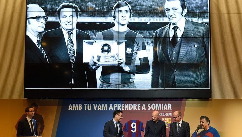 Jordi Cruyff (second right), son of late Dutch great Johan Cruyff, Jposes with Barcelona's president Josep Maria Bartomeu (second left) and Barcelona's vice president Jordi Cardoner (right) next to the
