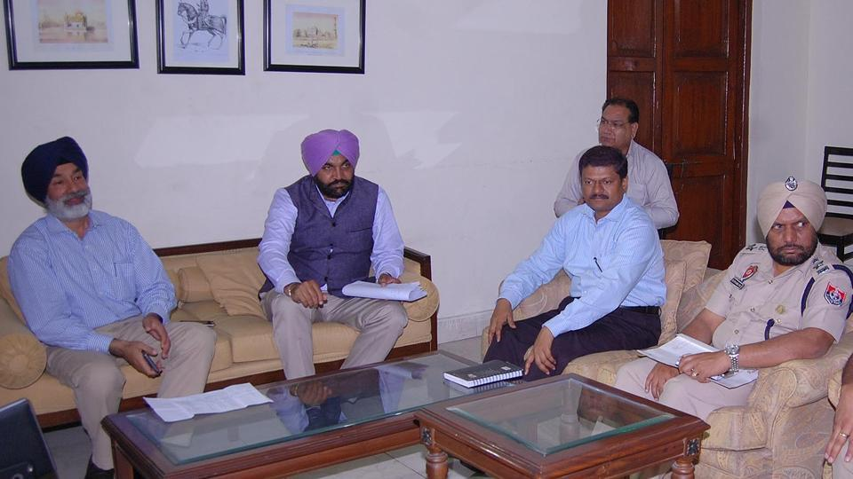 Amritsar MP Gurjit Singh Aujla (2L) during a meeting with police commissioner Nageshwar Rao (2R), deputy commissioner Kamaldeep Singh Sangha (L) and other officials at Circuit House in Amritsar on Saturday.