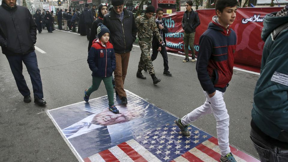 Iranians march on a portrait of US President Donald Trump and the picture of US flag in an annual rally commemorating the anniversary of the 1979 Islamic revolution which toppled the late pro-US Shah, Mohammad Reza Pahlavi,  in Tehran on Feb 10.