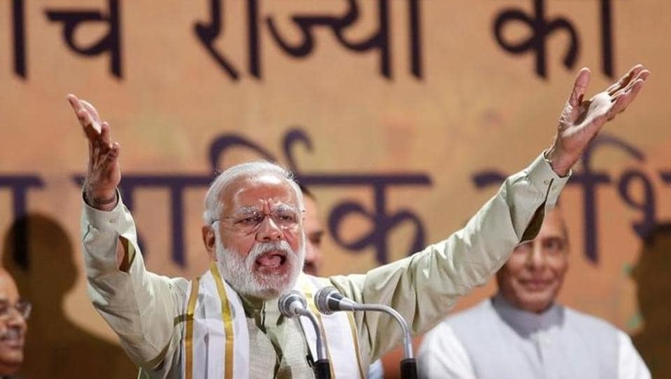 Prime Minister Narendra Modi addresses his supporters at Bharatiya Janata Party (BJP) headquarters in New Delhi.