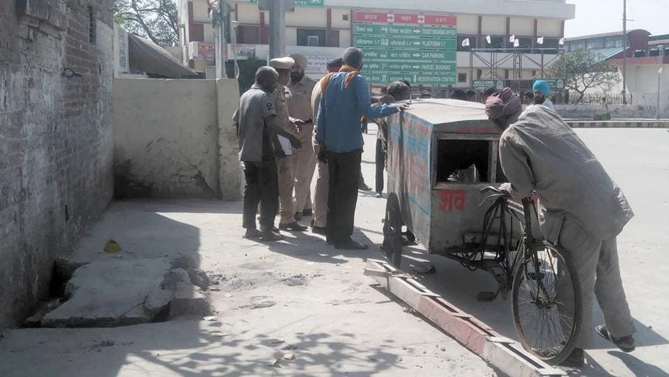 Police taking the body of an unidentified man which was found into an open manhole at Ludhiana railway station.
