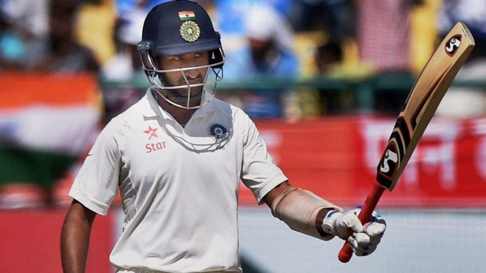 Cheteshwar Pujara celebrates his fifty during the second day of fourth Test match against Australia. (PTI)