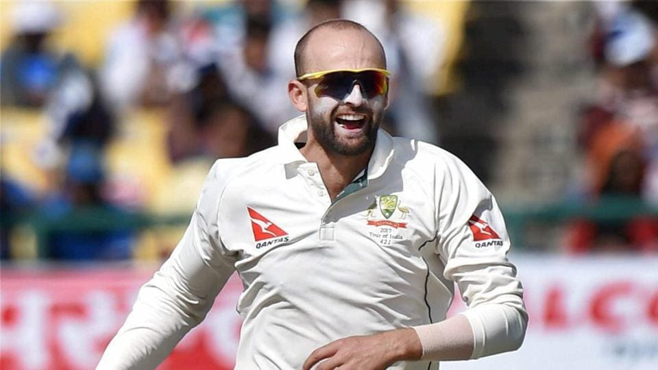 Australian spinner Nathan Lyon celebrates the wicket of India's Cheteshwar Pujara during the second day of last Test match at HPCA Stadium in Dharamshala on Sunday.