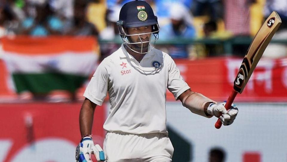 India's Cheteshwar Pujara celebrates his fifty during the second day of the last test match against Australia at HPCA Stadium in Dharamshala on Sunday.