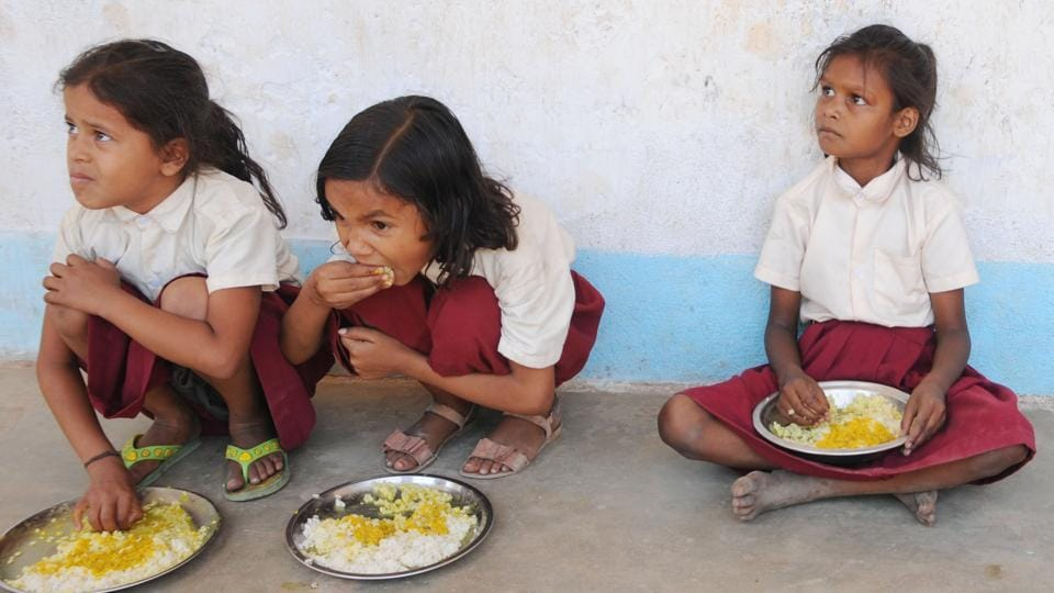 Primary school students have mid-day meals at a government middle school at Tharpakhna in Ranchi.