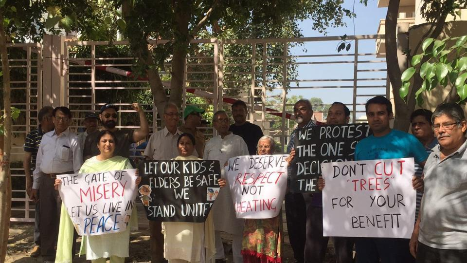 Residents of Block A of Sushant Lok 1 protested outside the Ivy Tower gate.