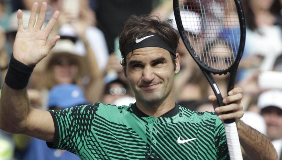 Roger Federer waves to the crowd after defeating Frances Tiafoe at Miami Open on Saturday.