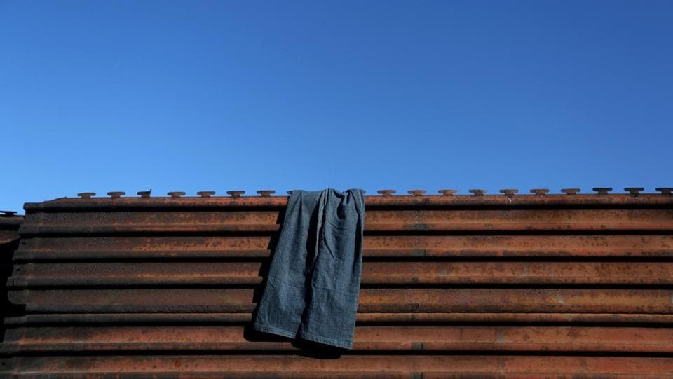 Pants hang on a section of the fence separating Mexico and the United States. (Edgard Garrido/REUTERS)